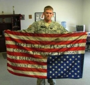 soldier w upside US flag w writing: No flag large enough...